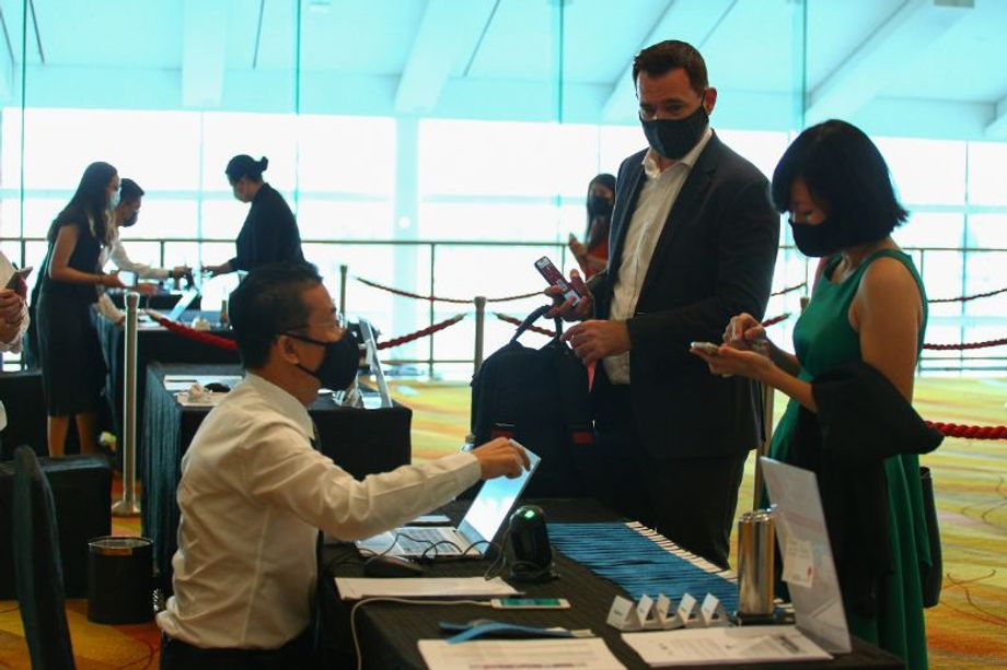Onsite participants checking in to the recent IBTM Wired hybrid event.