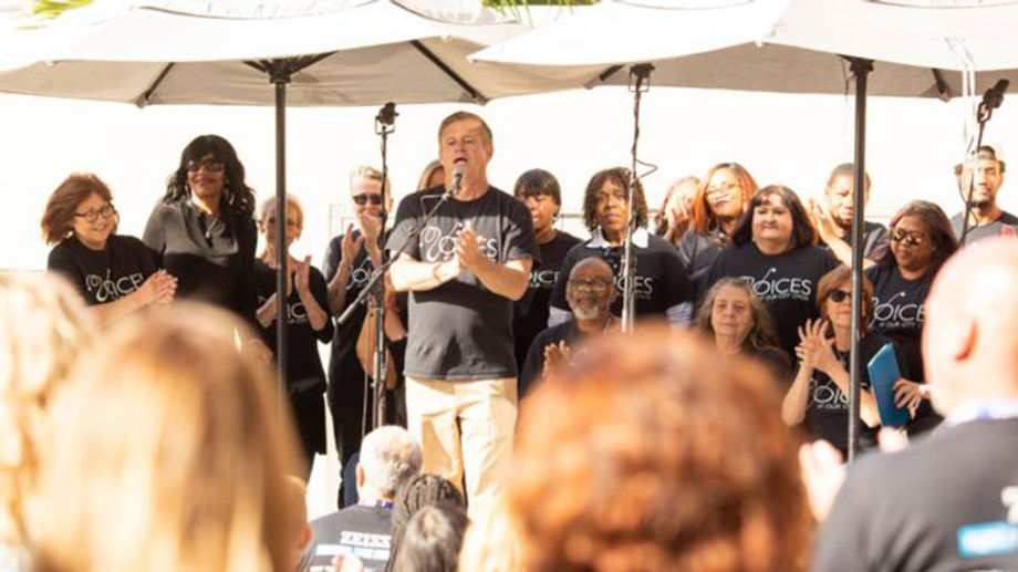 Attendees at Carl Zeiss Vision Inc.'s annual sales meeting enjoyed a performance after assembling and donating more than 2,000 sanitation kits for Voices of the City, a nonprofit choir organization that aids those experiencing homelessness.