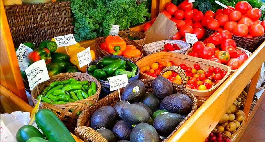Spending time at a farmer's market and experience the local tastes is an effective way to find ways to connect an event's menu with local dishes, inexpensively.