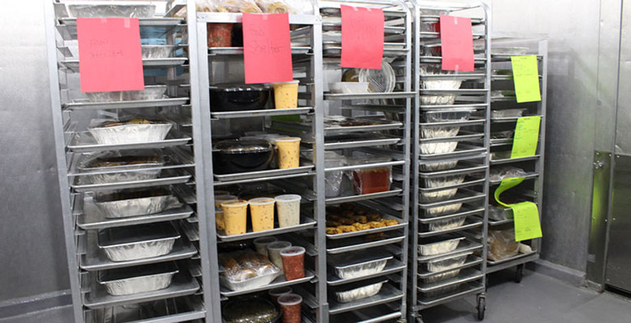 Racks of food ready to be picked up from the Raleigh (N.C.) Convention Center