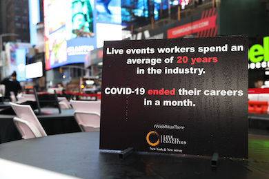 All tables and chairs were outfitted with signs that spoke to the devastating impact the virus has had on the events industry.