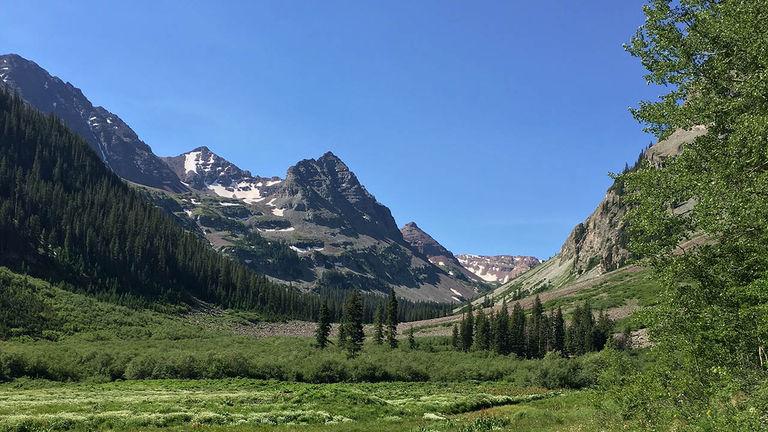The hike to Crater Lake brings trekkers through verdant valleys.