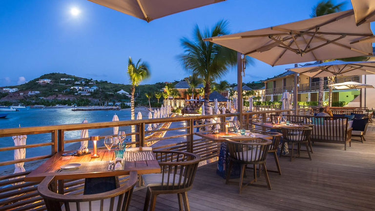 The ultra-luxurious Le Barthelemy Hotel & Spa features a lively rooftop bar and Michelin-starred cuisine.