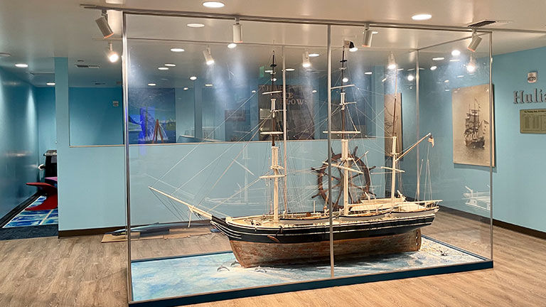 A replica of a whaling ship is among the center's exhibits.