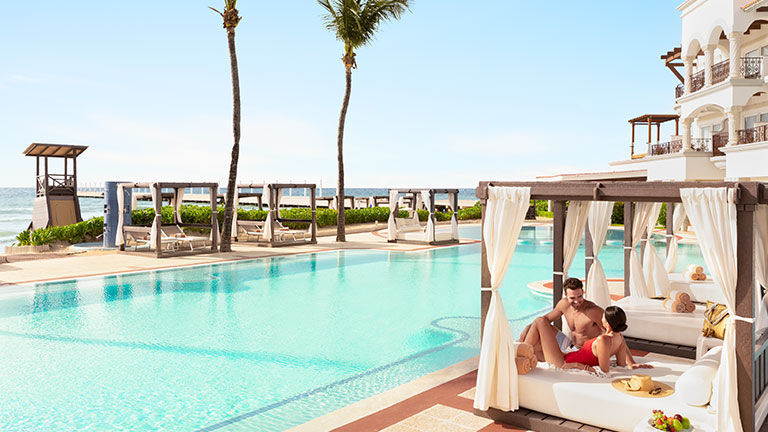 The hotel features an expansive pool area with plenty of cabanas.