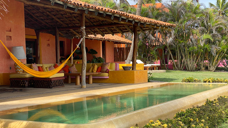 Las Alamandas is located approximately two hours from Puerto Vallarta's airport and features villa accommodations.