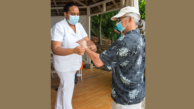 Upon arrival in St. Lucia with Windstar, guests' temperatures were taken and a bracelet identified visitors.