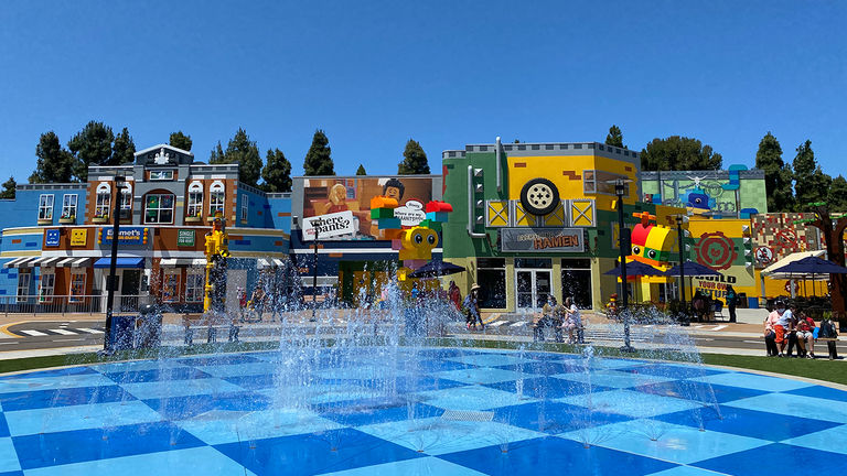 The colorful new land has three new eateries and six new attractions.