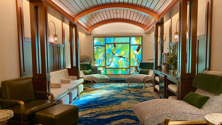 The yellow tones in the relaxation lounge stained-glass window depicts sun rays that represent fire.