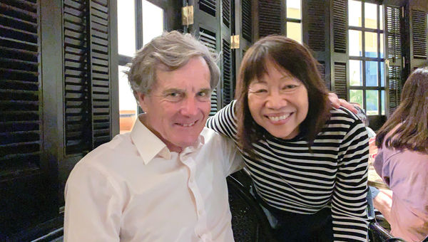 Actor Nicholas Hammond and the author at the Long Bar at the Raffles Singapore, which remains a tourist draw despite coronavirus fears.