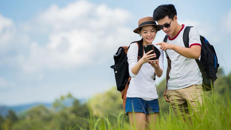 Chinese travelers [Credit: Torwai Studio/Shutterstock.com]