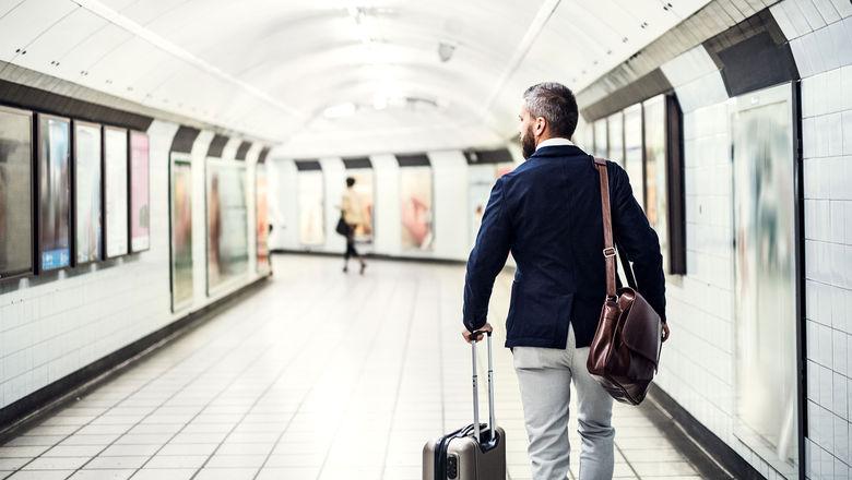 Business traveler [Credit: Halfpoint/Shutterstock.com]