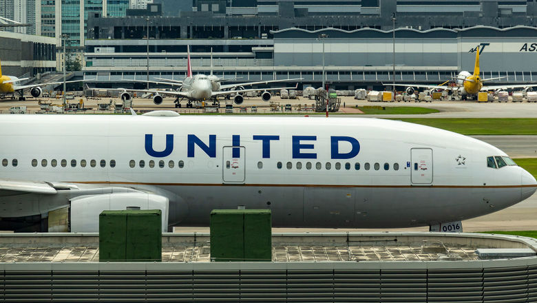 United 777 in Hong Kong [Credit: Chintung Lee/Shutterstock.com]