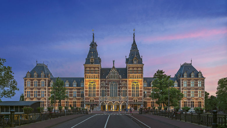 The Rijksmuseum in Amsterdam at dusk. Uniworld is providing new nighttime excursions in five European cities, including a canal cruise experience in Amsterdam.
