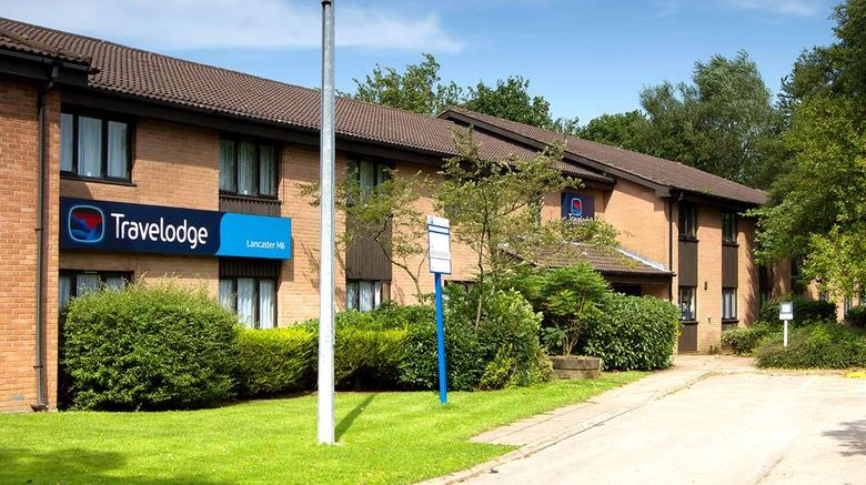 """Travelodge Lancaster M6 Exterior. Images powered by <a href=""""http://web.iceportal.com"""" target=""""_blank"""" rel=""""noopener"""">Ice Portal</a>."""