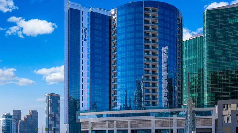 """Radisson Blu Hotel, Dubai Waterfront Exterior. Images powered by <a href=""""http://web.iceportal.com"""" target=""""_blank"""" rel=""""noopener"""">Ice Portal</a>."""