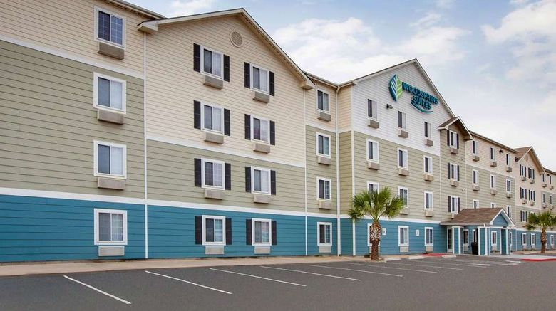 """WoodSpring Suites Pharr Exterior. Images powered by <a href=""""http://web.iceportal.com"""" target=""""_blank"""" rel=""""noopener"""">Ice Portal</a>."""
