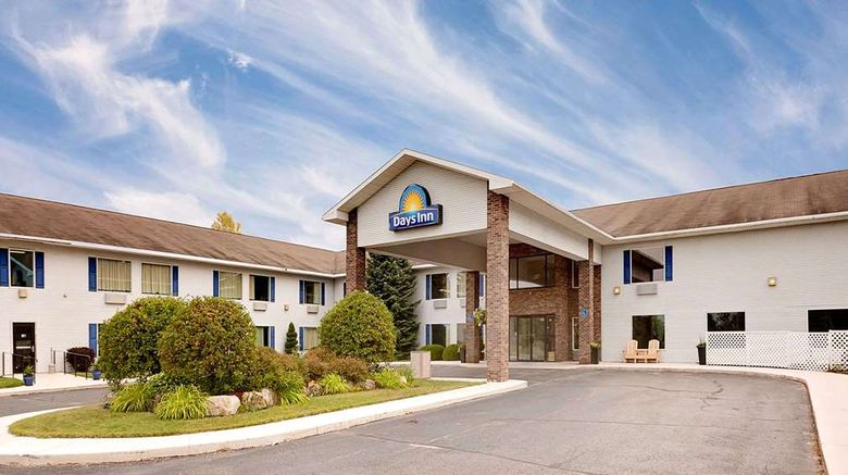 """Days Inn Cadillac Exterior. Images powered by <a href=""""http://web.iceportal.com"""" target=""""_blank"""" rel=""""noopener"""">Ice Portal</a>."""