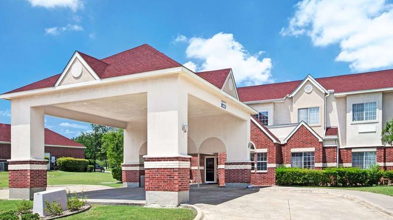"""Microtel Inn  and  Suites Dallas At Highway Exterior. Images powered by <a href=""""http://web.iceportal.com"""" target=""""_blank"""" rel=""""noopener"""">Ice Portal</a>."""