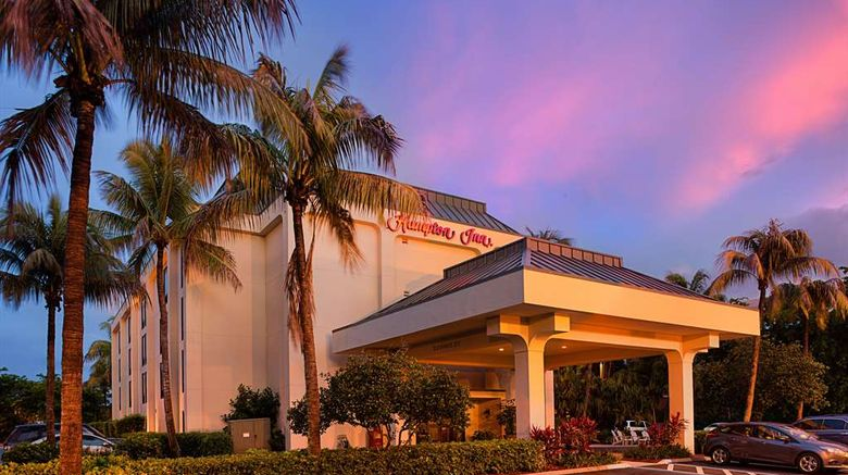 """Hampton Inn Naples Central Exterior. Images powered by <a href=""""http://web.iceportal.com"""" target=""""_blank"""" rel=""""noopener"""">Ice Portal</a>."""