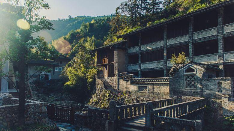 """Tsingpu Tulou Retreat Exterior. Images powered by <a href=""""http://www.leonardo.com"""" target=""""_blank"""" rel=""""noopener"""">Leonardo</a>."""