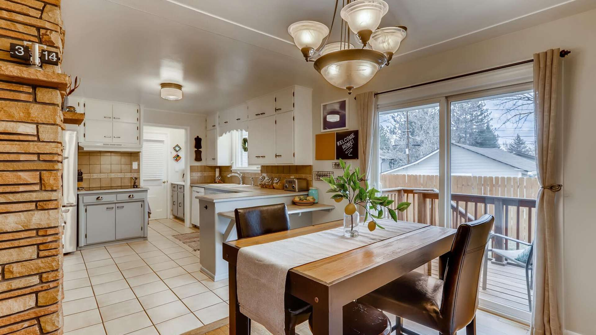 11 of 38. Dining room with sliding glass door to private backyard