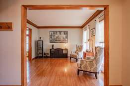 Hardwood Floors Continue into the Formal Living Room