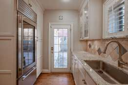 Glass Front Sub-Zero Refrigerator & Easy Access to Garage Parking