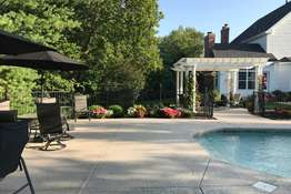 Enjoy being poolside while admiring the park-like setting!