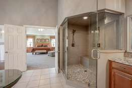 Huge Custom Tiled Walk-In, Multi Head Shower with a Large Built-In Bench