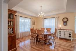 Dining Area with Coffered Ceiling and Crown Molding