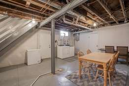 Unfinished Lower Level has a walk-up to the backyard, a large cedar closet, plenty of storage space, and access to the garage!