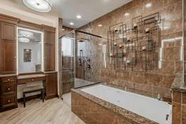 Separate Jetted Tub with a Waterfall Faucet