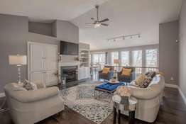 Vaulted living space features hardwood flooring & beautiful built-ins!