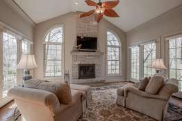 Hearth Room with a Floor-to-Ceiling Stone Fireplace (Wood Burning)