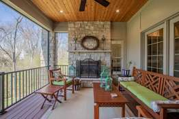 Wood Planked Ceiling, and a Floor-to-Ceiling Stone Fireplace (Gas)
