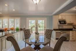 Adjoining Breakfast Room with Access to the Expansive Patio