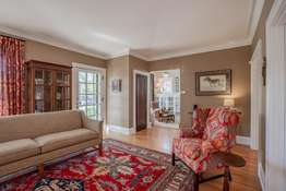 Crown Molding and Gleaming Hardwood Flooring Found Throughout the Home