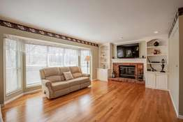 Great Room with Large Bay Window, Brick Gas Fireplace