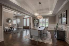 Formal Dining Room with Double Tray Ceiling, Chair Rail and Wainscoting