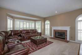 Gas Fireplace with a Brick Surround and Wood Mantle
