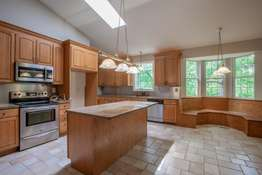 Center Island / Breakfast Bar, and a Custom-Built Dining Nook with Banquette Seating