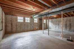 The unfinished Lower Level has a deep pour, and rough-in plumbing for your future finishes!