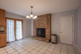 Brick Fireplace in the Eat-in Space