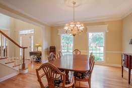 Chair Rail, Crown Molding, and Floor to Ceiling Windows