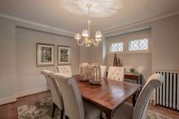 Generous Dining Room with delightful stained-glass windows, and crown molding!