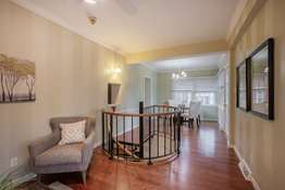 A brilliant spiral staircase leads you to the Family Room!