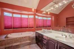 Dual Sink Vanity and Soaking Tub