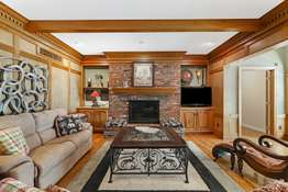 Gas Fireplace Flanked by Custom Built-Ins