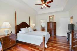 Master Includes a Tray Ceiling, Bay Window, and Spacious Walk-In Closet